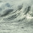 Close-up to breaking wave - Stock Photo