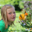 Young girl in the garden — Stock Photo #5939389