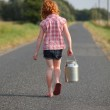 Young girl with milk can — Stock Photo #5939410