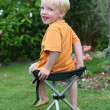 Royalty-Free Stock Photo: Kid on a folding chair