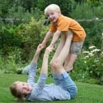Happy kids in the garden — Stock Photo #5939714
