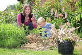 Woman and son work in the garden — Stock Photo
