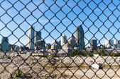 City behind a fence — Stock Photo