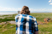 Man looking at the horizon — Stock Photo