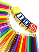 Colour pencils with learning blocks — Stock Photo