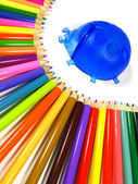 Rainbow of color pencils and stand ladybird — Stock Photo