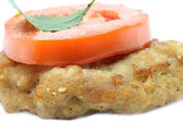 Cutlet and tomato — Stock Photo