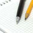 Notepad with pen and pencil — Stock Photo