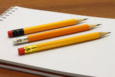 Notpad and pencils — Stock Photo