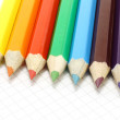 Big colour pencils on the notepad — Stock Photo