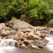 A cascade on rock falling into river — Stock Photo
