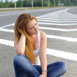 Royalty-Free Stock Photo: The girl at the highway