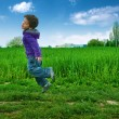 Jumped boy on green meadow — Stock Photo #5953845