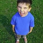 Young boy tongue sticking — Stock Photo #5953848