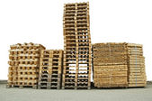 Stacks of New wooden pallets — Stock Photo