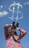 Woman watching with binoculars — Stock Photo