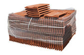 Pile of roofing tiles packaged. — Stock Photo