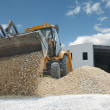 Excavator unload gravel — Stock Photo
