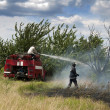Stock Photo: Firefighters extinguish fire