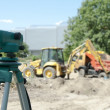 Stock Photo: Surveying equipment to construction site