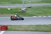 Boy drive car on kart track — Stock Photo