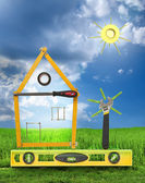 House with tree and sun made of tools for building.White isolate — Stockfoto