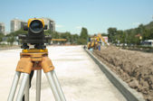 Surveying equipment to infrastructure construction project — Stock Photo