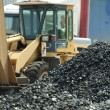 Excavator and coal piles - Stock Photo