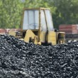 Stock Photo: Excavator and coal piles