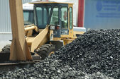 Excavator and coal piles — Stock Photo