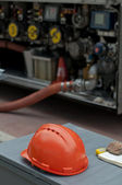 Fuel truck and helmet close up — Stock Photo