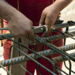 Construction worker ties reinforcing steel — Stock Photo