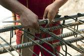 Construction worker ties reinforcing steel — Stock Photo