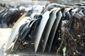 Old car parts and cables in automorgue — Stock Photo