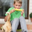 Stock Photo: Boy eating corn