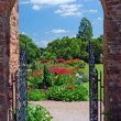 Stock Photo: Summer Garden through archway