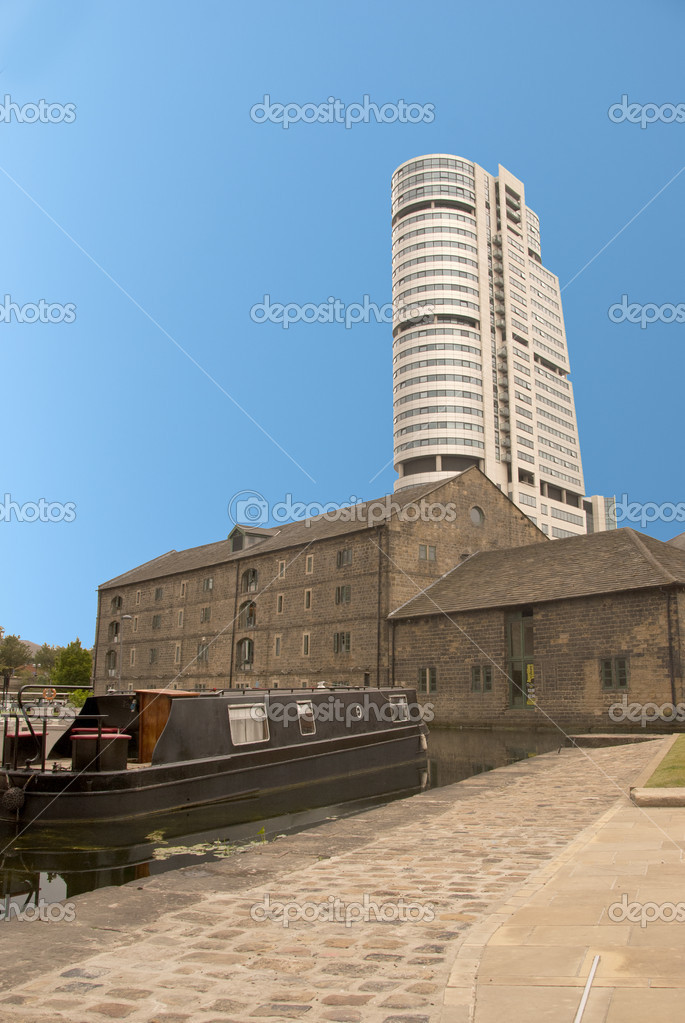 A Tower Block overlooking Canal side Buildings and a barge — Stock Photo #5995976