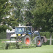 Tractor and Lawnmower - Stock Photo