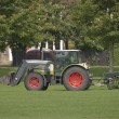 Stock Photo: Tractor and Lawnmower2