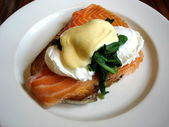 Smoked Salmon and poached eggs benedict — Stock Photo