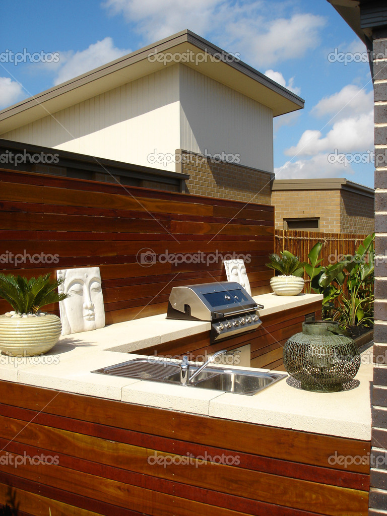 Stylish outdoor entertaining area with barbequeue    Stock Photo #6156472