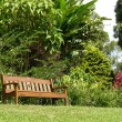 Sunny relaxing garden seat — Stock Photo