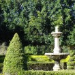 Formal garden and statue — Stock Photo