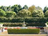 Fountain in formal garden — Stock Photo