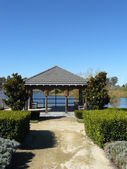 Gazebo portico at lake's edge — Stock Photo