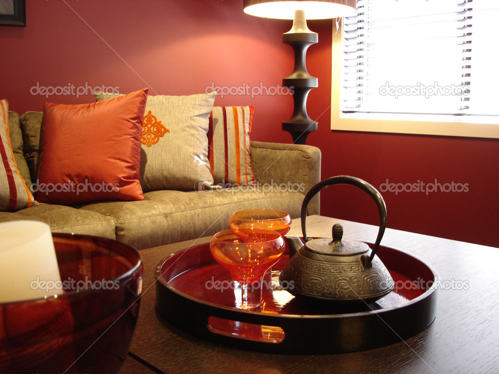 Modern loungeroom with decorator furnishings in hot spicy colours — Stock Photo #6222428