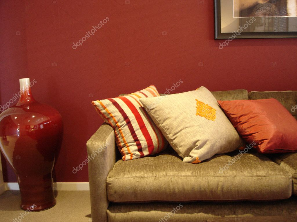 Modern loungeroom with decorator furnishings in hot spicy colours — Stock Photo #6222429