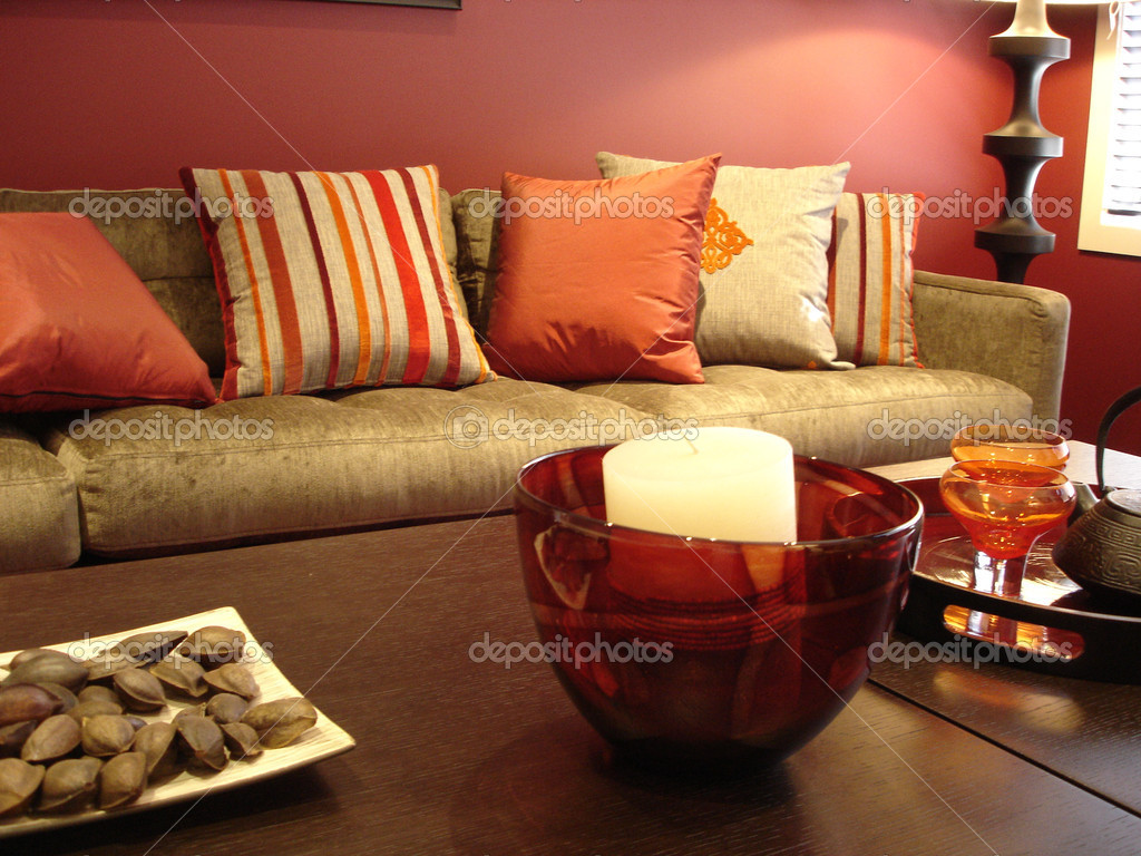 Modern loungeroom with decorator furnishings in hot spicy colours — Stock Photo #6222430