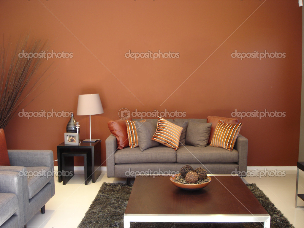 Modern loungeroom with decorator furnishings in hot spicy colours — Stock Photo #6222432