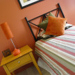 Modern bedroom warm tones orange — Stock Photo